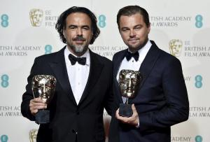 Best director Alejandro Inarritu and best leading actor Leonardo DiCaprio hold their awards at the British Academy of Film and Television Arts (BAFTA) Awards at the Royal Opera House in London